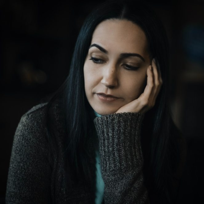 selective-focus-portrait-photo-of-sad-woman-in-gray-sweater-2423932